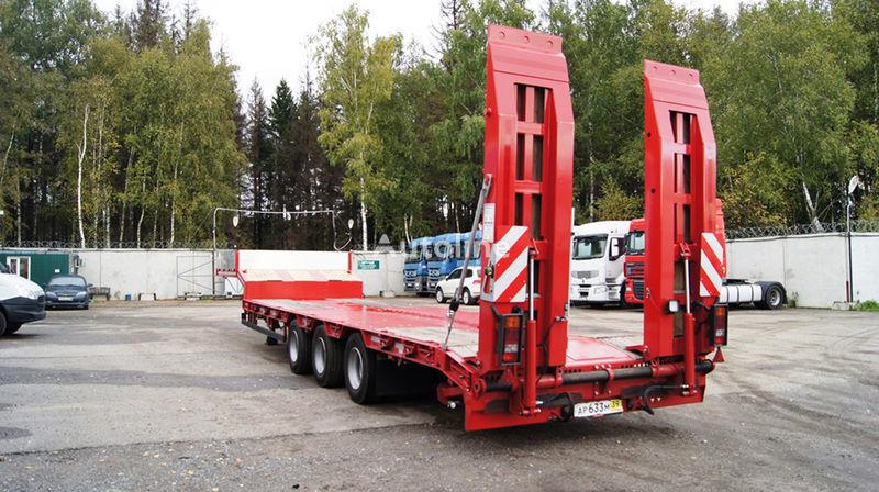 новый полуприцеп низкорамная платформа GRUNWALD Triaxial low bed semitrailer